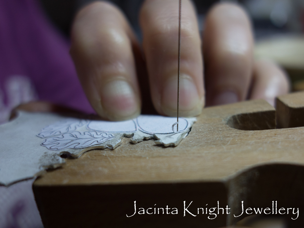 Making textured earrings - cutting out the shapes from a sheet of silver.
