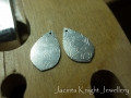 Making textured earrings - the earring pieces after texturing, ready to be polished.
